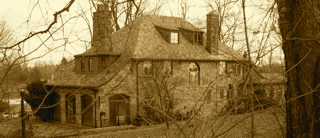 An old sepia-toned photo of the Demon House.