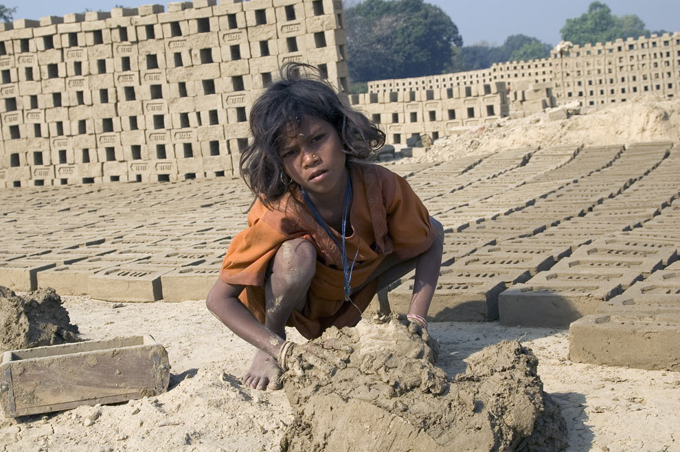 Photo of a nine-year old girl who was trafficked and sold to a brick-making factory